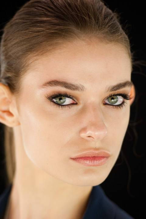 All was au naturel at the Dennis Basso show save for some intense liner, applied all around the rims of models' eyes. Makeup artist Jamie Greenberg used Avon SuperShock Gel Eyeliner so for £6 you can steal the style right off the runway.
