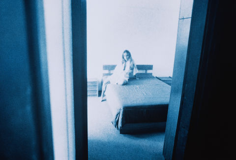 Girl scared and alone on a bed