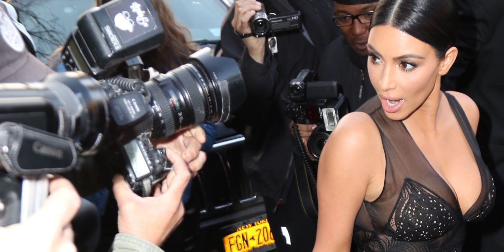 Here's what happened when a paparazzo stepped on Kim Kardashian's dress