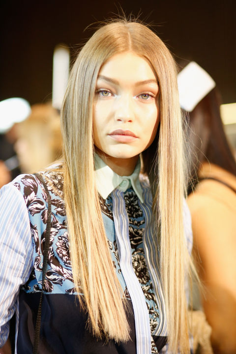 Pin-straight hair is back. Yup, the 00s style is oh-so cool again thanks to Versace and Gigi Hadid. Time to dust off your straighteners, peeps.