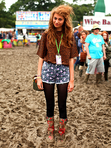 Lucy went bold, colour clashing her prints in floral Topshop shorts and a leopard print top she found in a charity shop