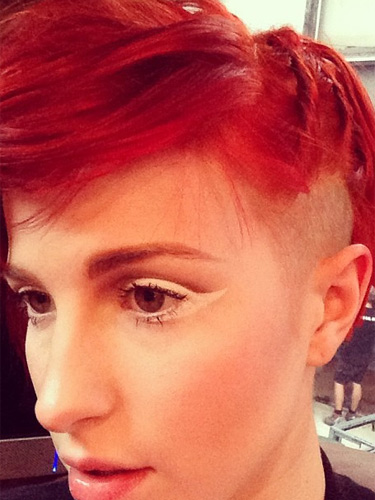 Paramore singer Hayley Williams reveals a new red hair colour and side,shaved crop.